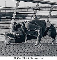 Streching by the riverside - Woman streching by the...