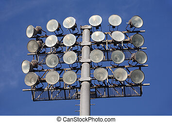 Soccer or Baseball Floodlights against a blue sky