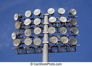 Soccer or Baseball Floodlights against a blue sky