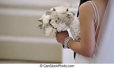 Bride with bouquet at wedding ceremony