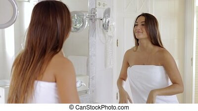 Content woman posing in bathroom - Young confident woman...