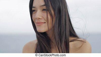 Beautiful woman posing at camera - Headshot of young...