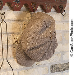 Old farmers hat hanging on a hanger - The Netherlands