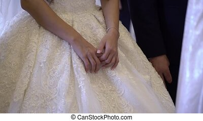 Bride and groom at wedding ceremony indoors