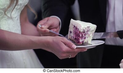 Bride and groom with piece of wedding cake slowmotion