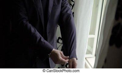 Man wearing jacket silhouette slowmotion