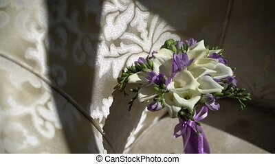 Bridal bouquet on sofa at sunny day