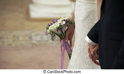 Bride and groom at wedding ceremony - Bride and groom...
