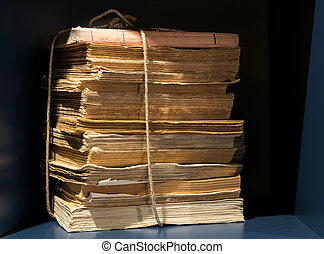 Stack of old yellowed books and papers - Stack of old...