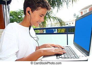 teenager student happy boy laptop earphones homework in...