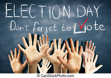 Election day concept - Many waving hands on chalkboard...