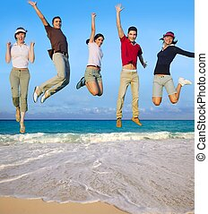 Jumping young people happy group tropical beach - Jumping...