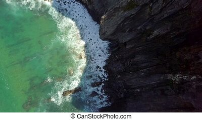 Turquoise water washing beach - Top aerial view of crystal...