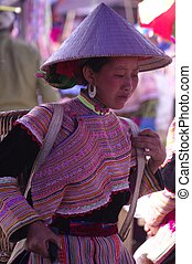 Portrait of a young Hmong woman flo - Can Cau market, this...