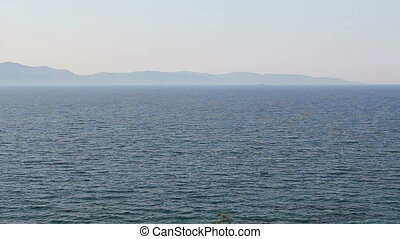 Landscape of open sea with islands in background - Far away...