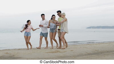 People Walking On Beach Using Cell Smart Phones Online...