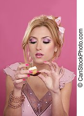 barbie beautiful blonde eating diet sweet on pink background