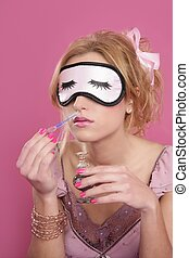 blond woman smelling perfume sleep mask blind pink...