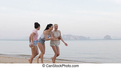 Girls Walking On Beach Holding Cell Smart Phone Laughing,...