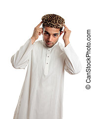 Ethnic man in robe and hat - An ethnic man in white...