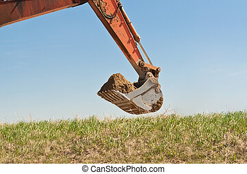 Hydraulic Excavator Arm and Bucket - The arm and bucket of a...
