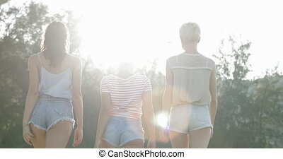 Girls Walking Back Rear View Outdoors In Park, Young Women...