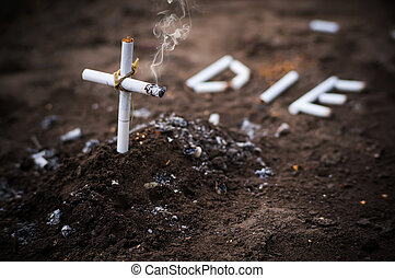 a cross from butts. Smoking kills. word die laid out the...