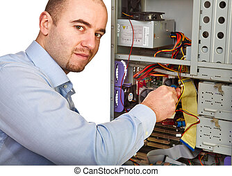 man repair computer - young worker on duty repair pc