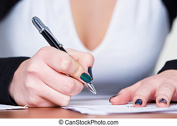 Writing girl - Young business woman writing document in...
