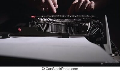 Poet types the text of the poem on a retro typewriter...