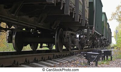 Long train running fast in slow motion on railway on...