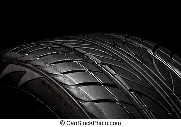 car tire, photo on the black background
