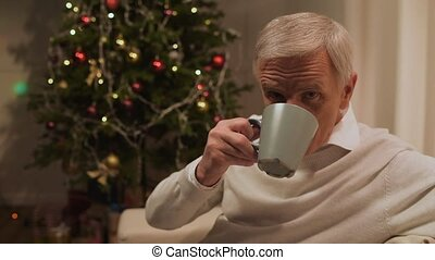 Joyful man drinking tea with cookies at home - Home made...