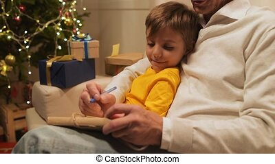 Positive aged loving man preparing Christmas presents with...