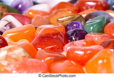 semi precious colorful stones, orange stone background -...