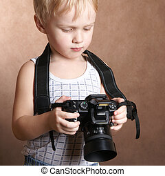 child in studio with professional camera