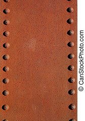 Rusty metal plate with rivets