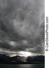 Moody Sky Portrait - Dark moody sky over mountain range, new...