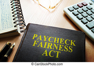 Book about Paycheck Fairness Act on a desk.