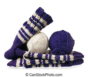 Warm knitted socks with threads isolated over white...