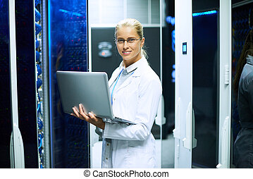 Female Scientist Working with Supercomputer - Portrait of...