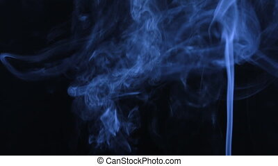 Double blue smoke on a black background. Beautifully. -...