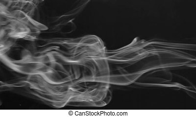 Clubs of white smoke pulsing on a black background....