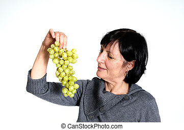 Aged woman with grapes