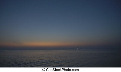 Sunset in the sea on the beach at the ocean 1
