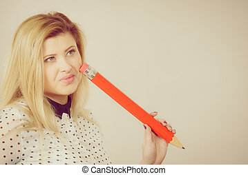 Woman confused thinking, big pencil in hand - Woman confused...