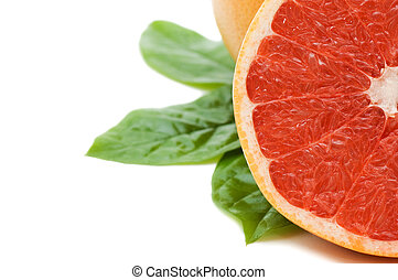 Fresh juicy grapefruits with green leafs. Isolated