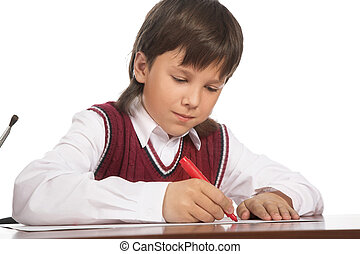writing boy isolated on the white background