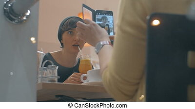 Getting shots to share in social media - Woman taking photos...