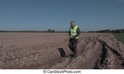 Farmer take pictures on the wet field